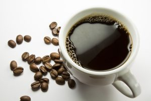 The cup of coffee and beans